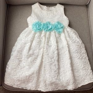 Ivory lace girl's dress with blue flowers.